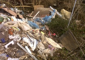 Another view of the fly-tipping, spread right down the sewer pipe bank