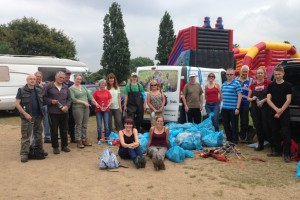 Seventeen of the Danson clean-up volunteers pose with the bags of collected rubbish at the conclusion of the event