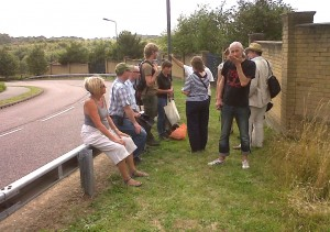 Braeburn tour participants included former Bexley Biodiversity Officer John Archer (second left), Parks, Open Spaces and Nature Conservation Officer Mark Taylor (third left)  and LWT's head of Planning and Policy Mathew Frith (second right), seen here looking at the geological SSSI by the housing estate access road.