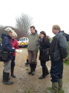 Chris Rose (ThamesRoad Wetland Site Manager) shows Crossness participants Ann, Paul, Donna and Mike a Harvest Mouse nest whilst discussing the plan of action. (Photo: Karen Sutton)