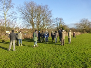 Attendees, sevaral ofwhom has never been to Crayford Rough before,  enjoy bird-watching in the winter sun. (Photo: Brenda Todd)
