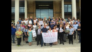 Old Farm Park campaigners, taking part in a photocall before presenting a petition to full Council on July 15th, had to respond quickly to key decision-making dates unexpectedly being brought forward.