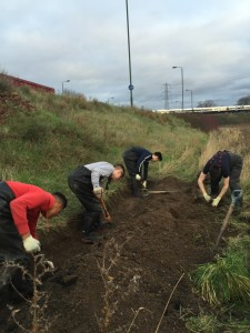 Crayford Academy pupils hard at work on the trench which, once planted up, is designed to intercept all oil residue washed off Thames Road and prevent it getting into the waterbody.