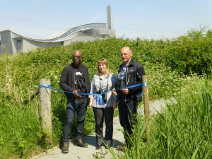 David Lindo, Karen Sutton and Andy Tomczinski prepare the cut the ribbon at the opening of the new bird hide at Crossness. Two four-stoey sheds on the Borax fields will have a massive negative impact on the view .... ( photo Ralph/BrendaTodd)